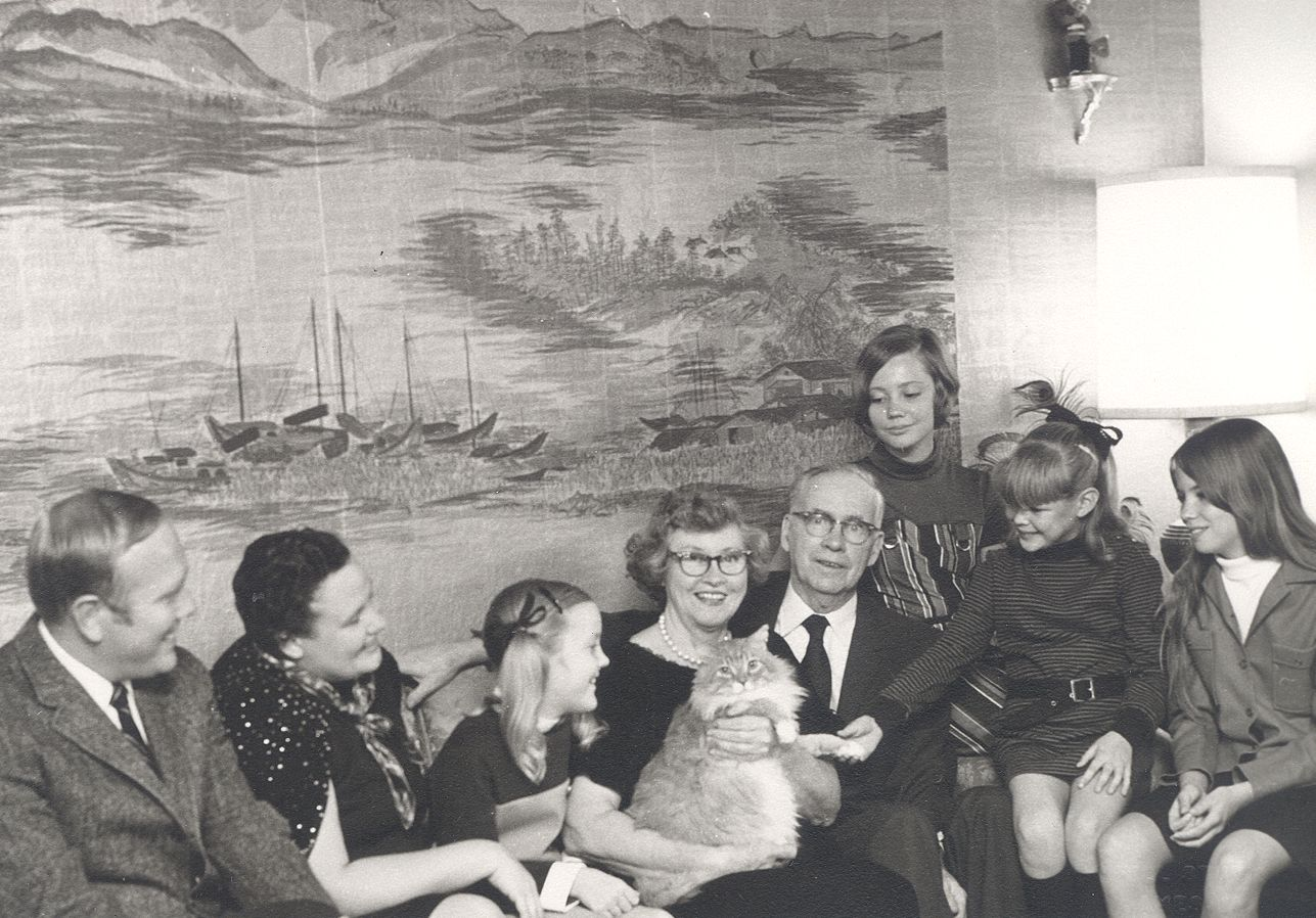 Thomas Irvine, proprietor of Irvine Paint and Wallpaper (214 5th Street) pictured with his wife, Lois (holding cat) and family at their home at 1101 16th ...