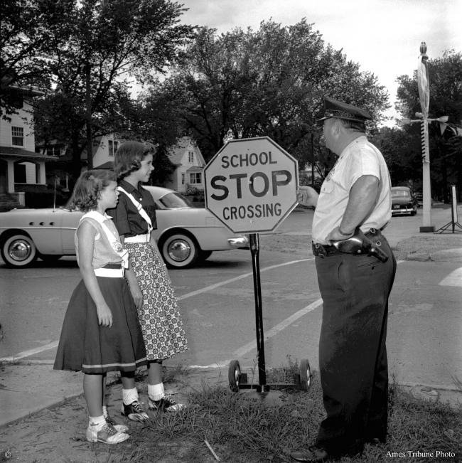 1957.09_school_crossing_guards_policeman_c.jpg