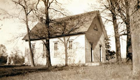This view of the church building was taken before the fence and basement were added.